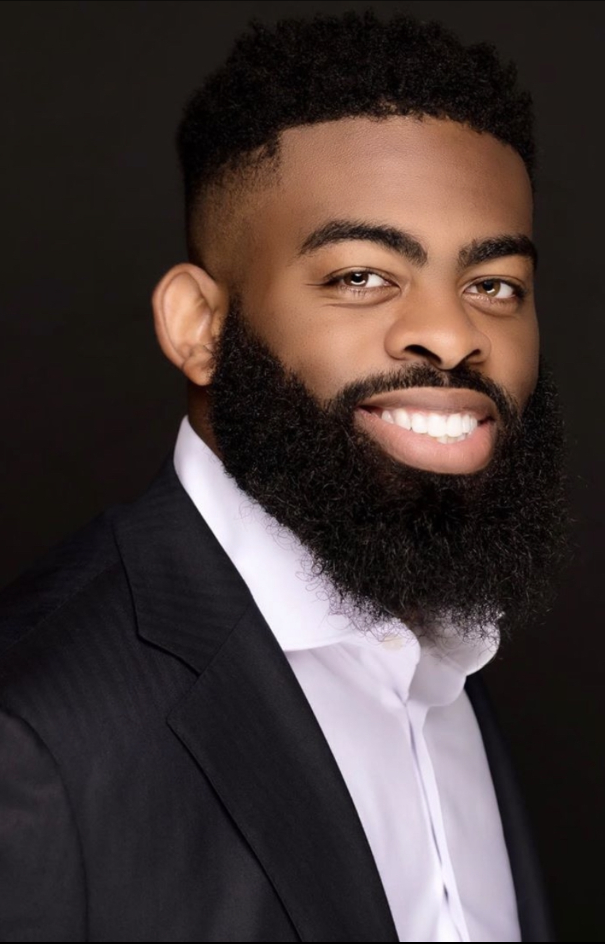 "A high quality headshot of real estate investor & entrepreneur Ogechukwu ""Money"" Madu"